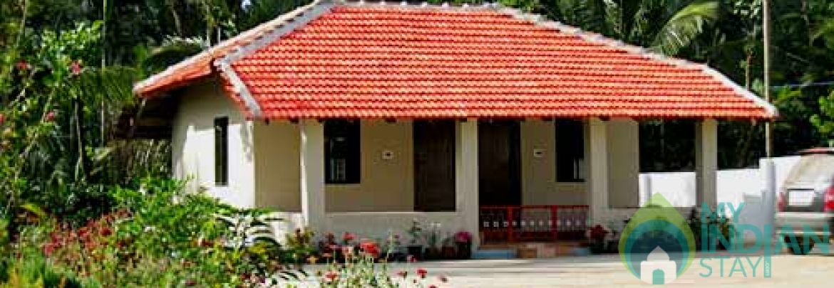 Twin bedrooms with double beds in Coorg