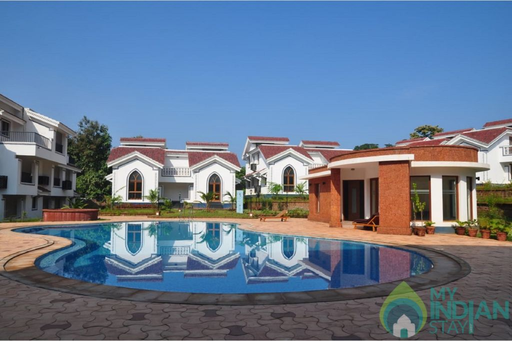 riviera-foothills-apartments-goa-pool-80666873054-jpeg-fs in a Serviced Apartment in Arpora, Goa