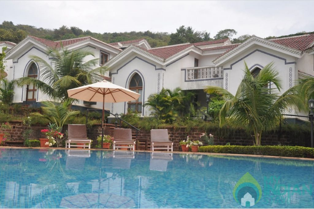 riviera-foothills-apartments-goa-pool-80666926348-jpeg-fs in a Serviced Apartment in Arpora, Goa