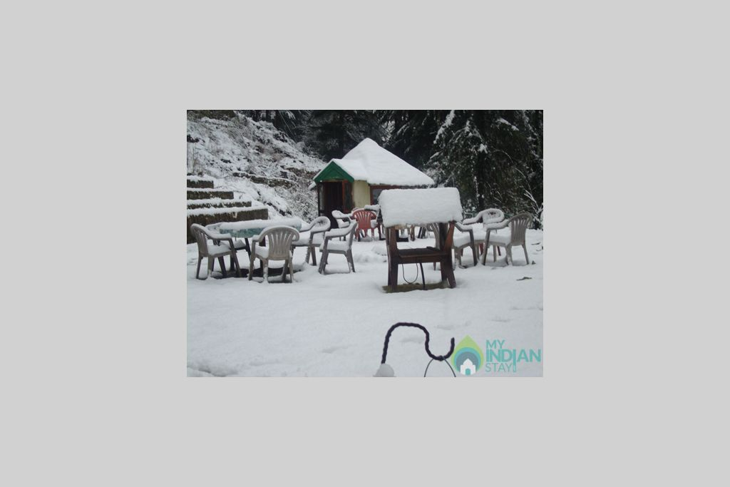Snow covered cottage in a Cottage/Huts in Kasol, Himachal Pradesh
