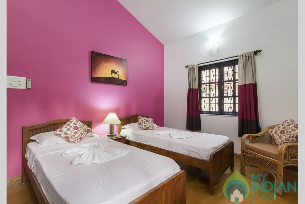 Pink Twin Bedroom -Each bedroom exuberates a touch of class in a House in Calangute, Goa
