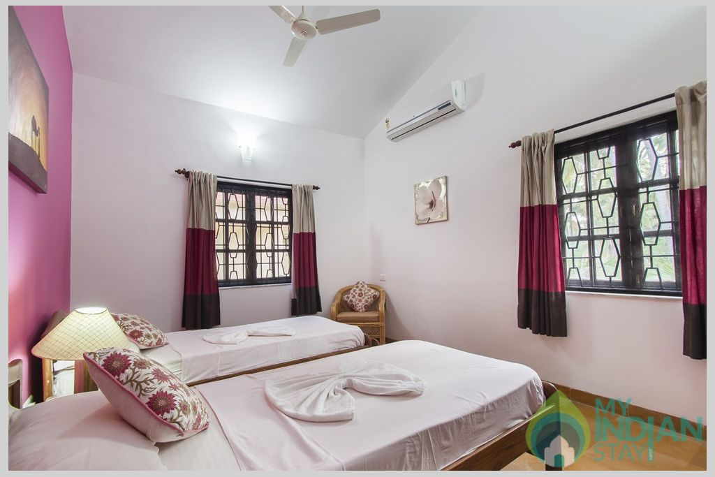 Pink Twin Bedroom- Bedrooms offer havens of space, comfort and serenity in a House in Calangute, Goa