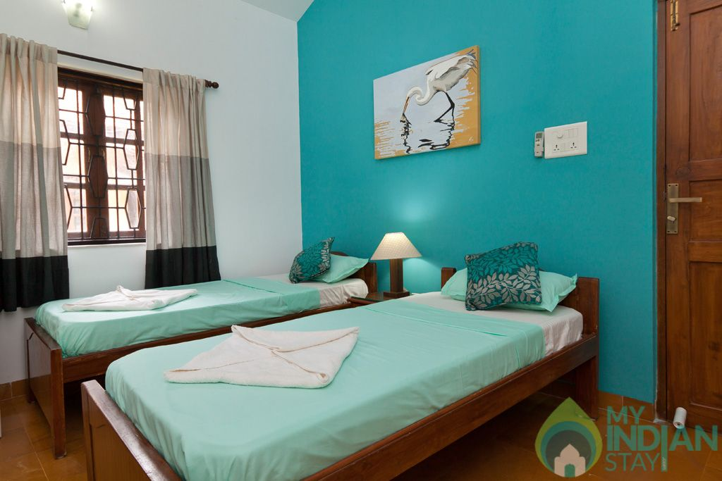 Green Twin Bedroom-Each bedroom comes with their own seating spaces, ceiling fan, ward in a House in Calangute, Goa