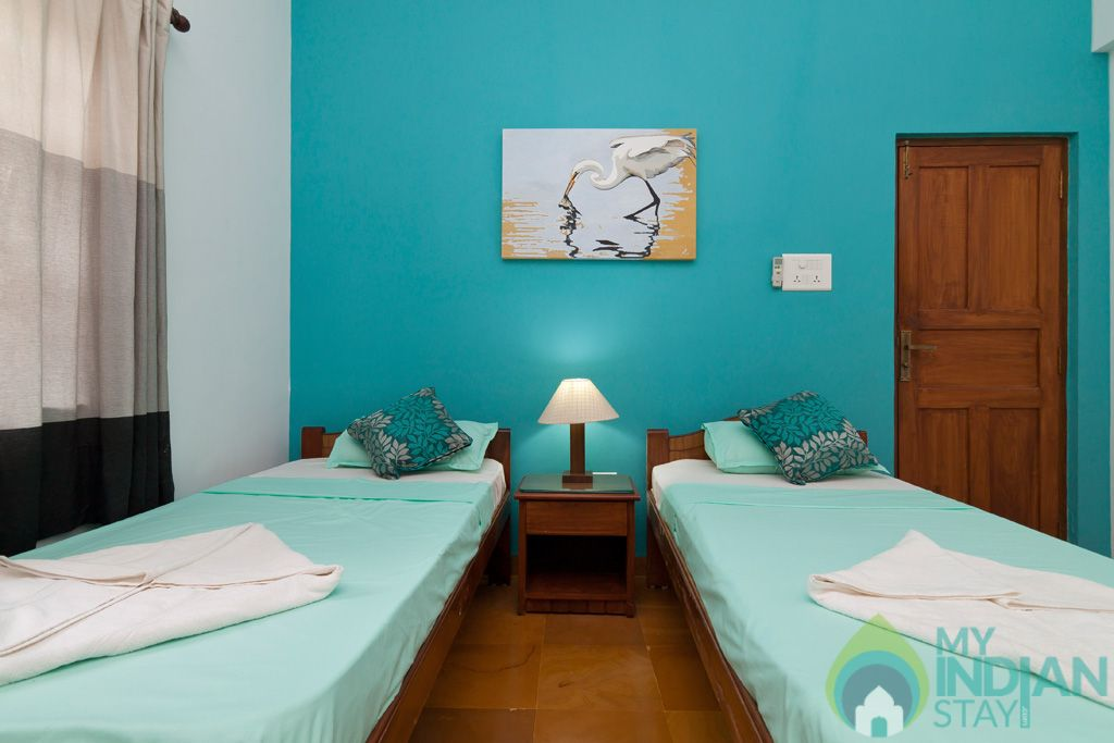 Green Twin Bedroom- Each bedroom is designed with thoughtful care and attention to detail in a House in Calangute, Goa