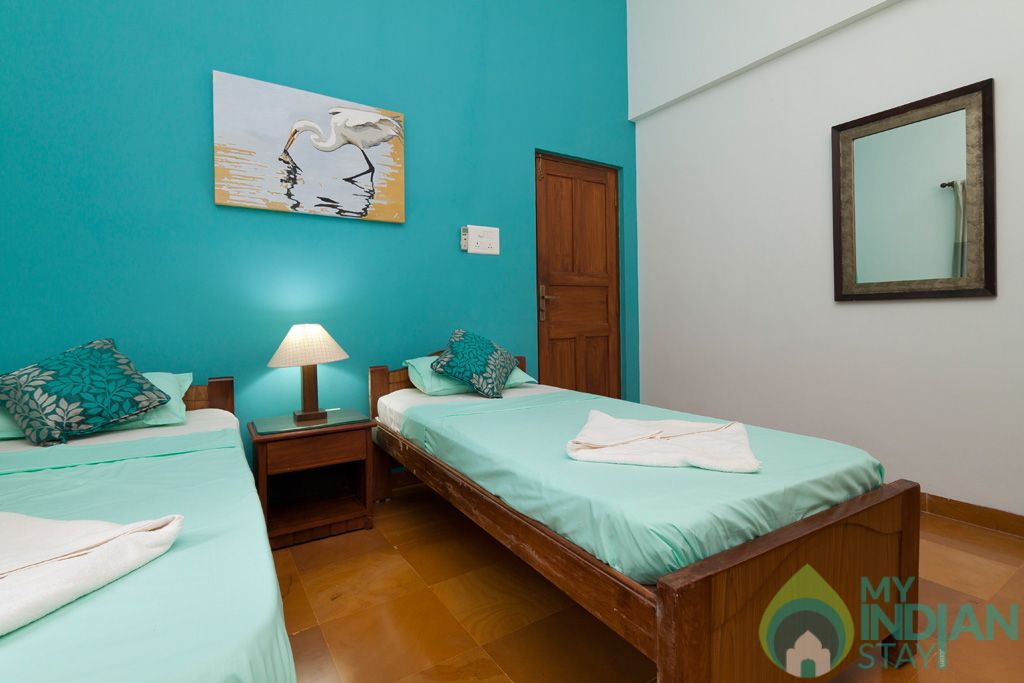 Green Twin Bedroom- Private balcony to capture the soothing breeze, and magnificent view of Goa in a House in Calangute, Goa