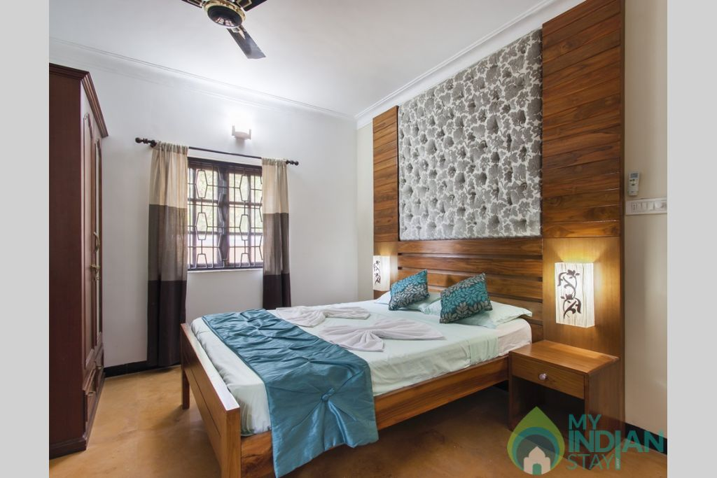 Green Master Bedroom-Each bedroom is designed with thoughtful care and attention to detail in a House in Calangute, Goa