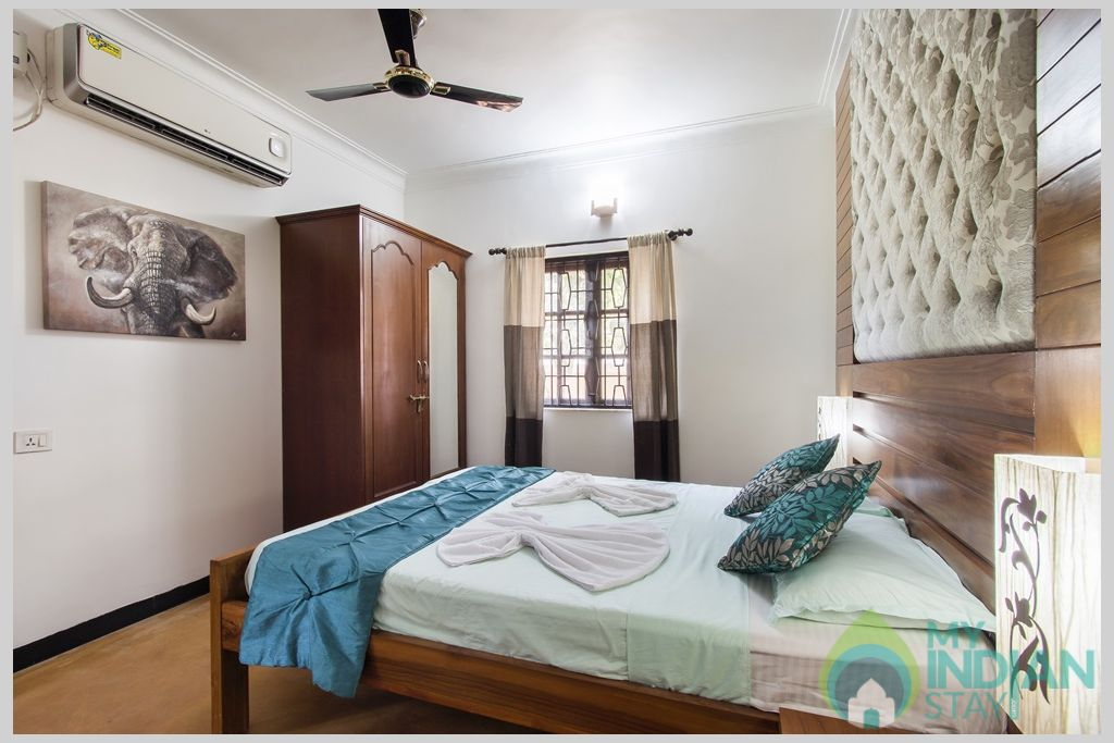 Green Master Bedroom- All your comforts have been though about with both day and night  in a House in Calangute, Goa