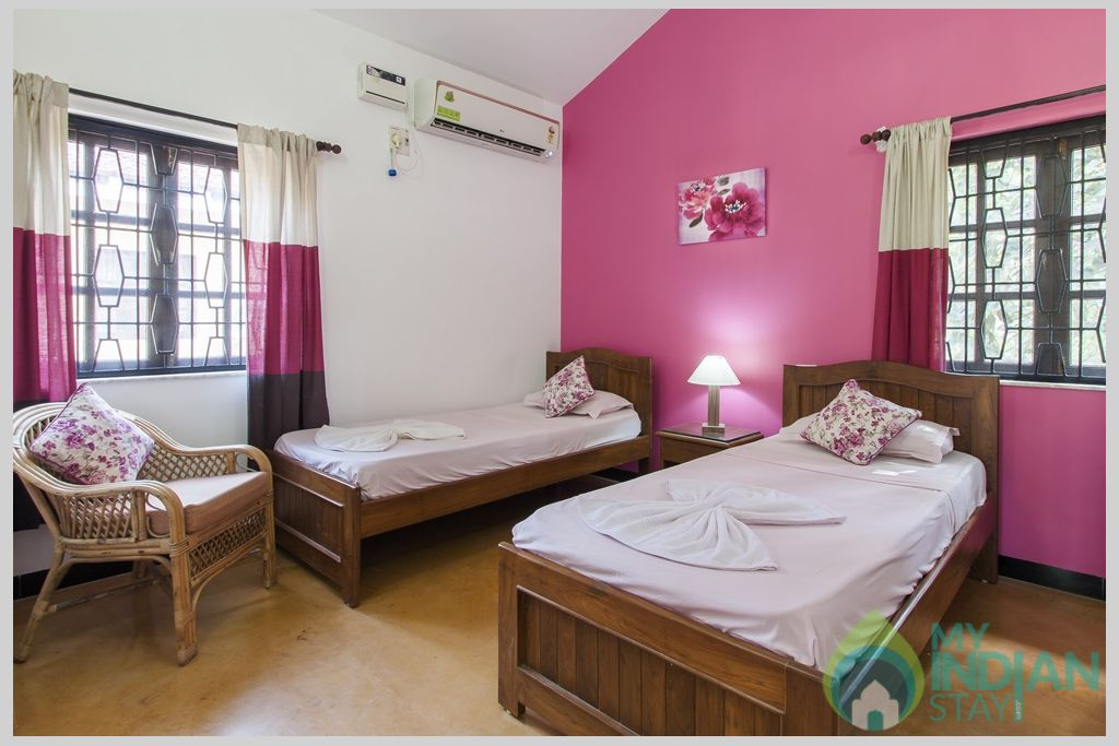 Pink Twin Bedroom - Each bedroom is designed with thoughtful care and attention to detail in a House in Calangute, Goa