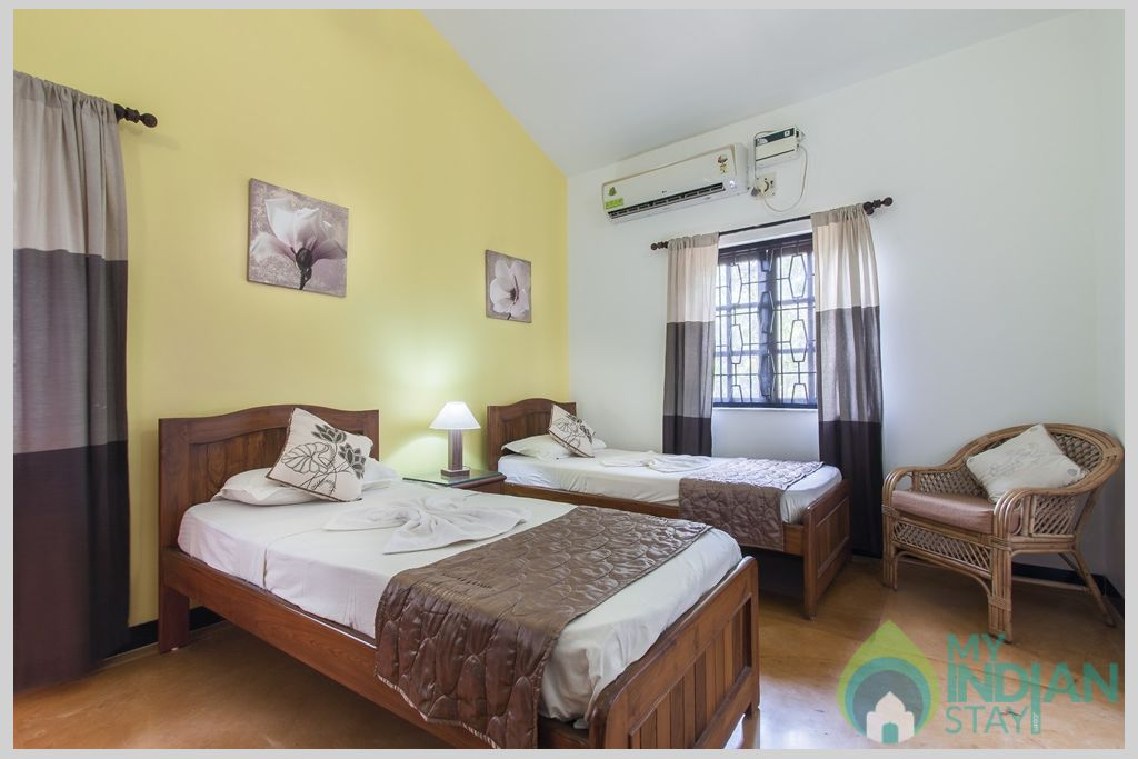 Lemon Twin Bedroom - Each bedroom comes with their own seating spaces, ceiling fan and wardrobe in a House in Calangute, Goa