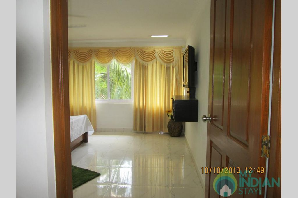 Bed room with LCD TV in a Serviced Apartment in North Goa, Goa