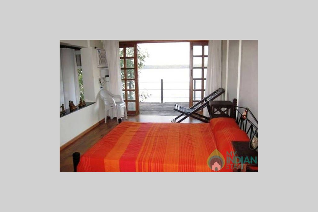TOP FLOOR BEDROOM OPEN TO WOODEN DECK in a Cottage/Huts in Velha Goa, Goa