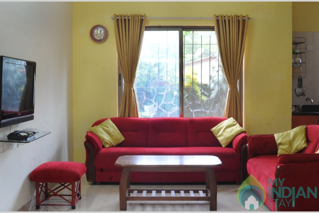 red sofa in a Villa in Lonavala, Maharashtra
