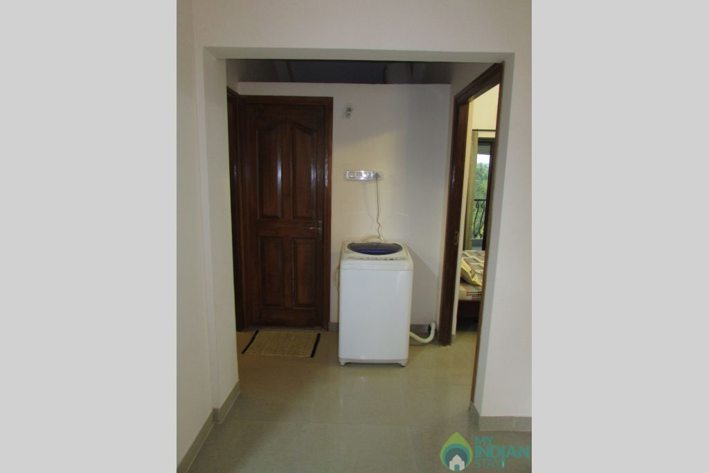 Washing machine  in a Serviced Apartment in Siolim, Goa