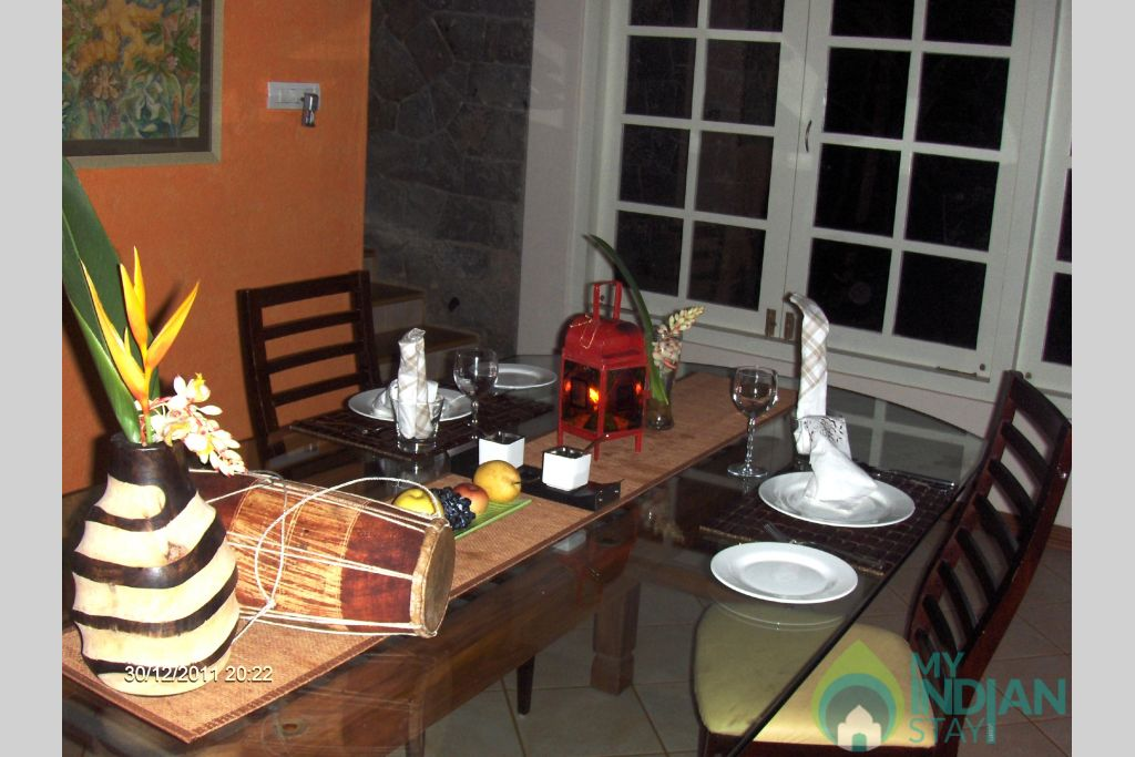 candle lit dinner table in a Villa in Idukki, Kerala