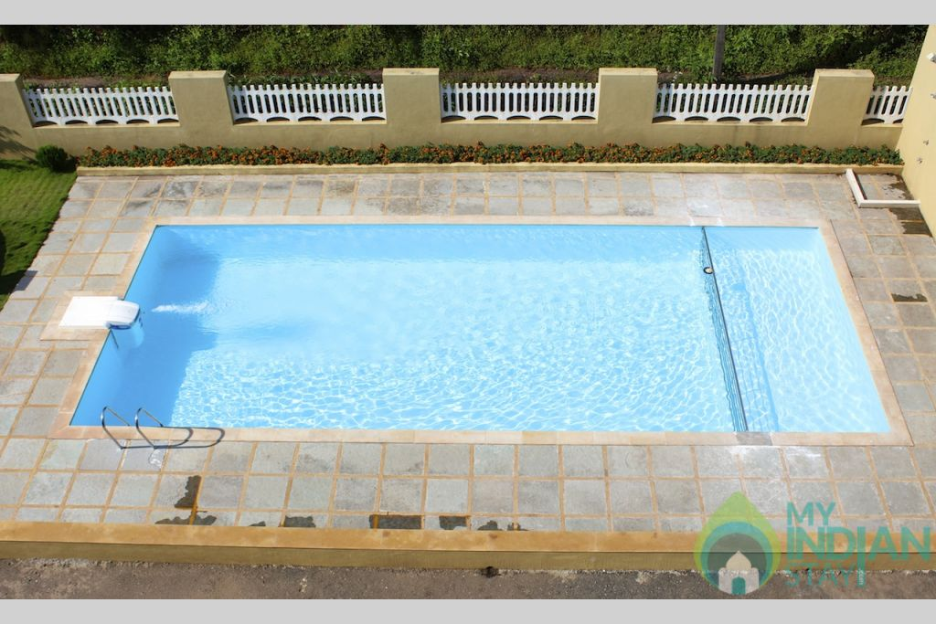 swimming pool in a Villa in Arpora, Goa