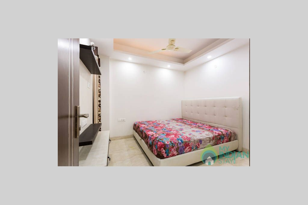 TV Wall Unit and Entry to Bedroom 3 in a Self Catered Apartment in Delhi, Delhi