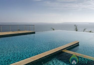 Marigold 2BHK Green view / Infinity Pool Apartment